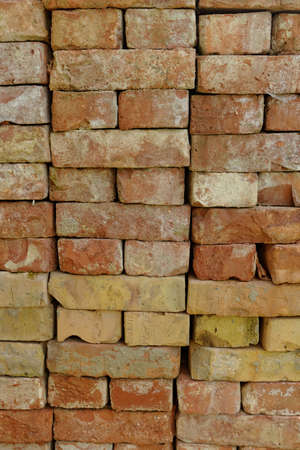 stacked red bricks on each other photo