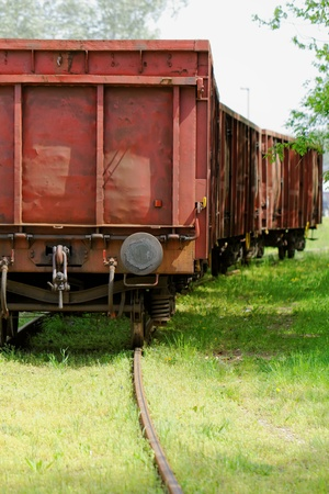 Old wagon, in an unused grassy railway track Stock Photo - 19746258