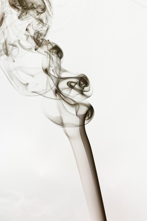 Gray smoke in white background photo
