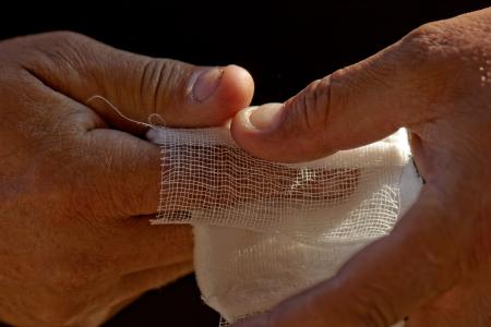 white medicine bandage on injury finger photo