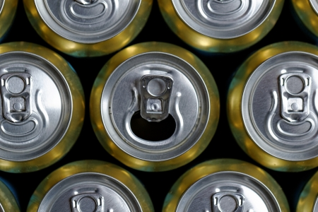 Much of drinking cans close up, one is open Stock Photo