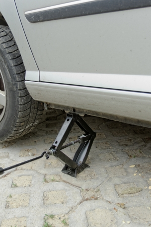 Car lifting for service with handlifter Stock Photo