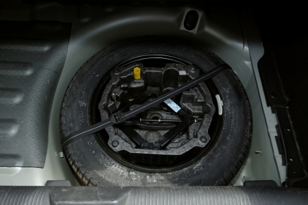 car lifter set for tire changing in the back of car Stock Photo