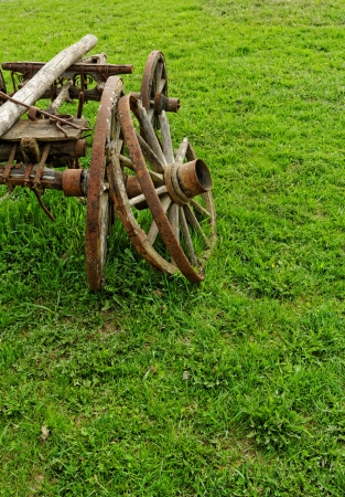 rust covered: old broken wooden wheel spokes, side by chariot