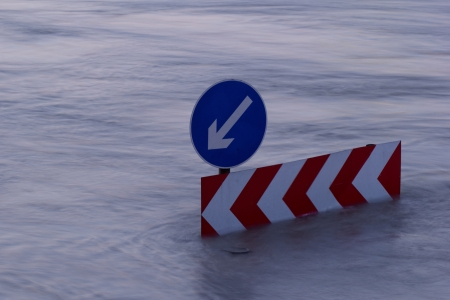 Direction indicator boards on the flooding river