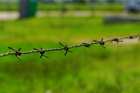 barbed wire defending the industries