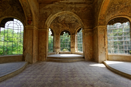 beautiful interior in a ruined castle with windows photo