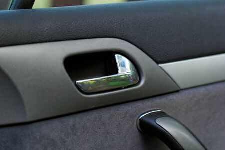 raiser: car door handle on a grey