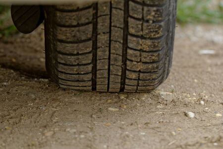 close up about car wheels on a dusty road Stock Photo - 20437331
