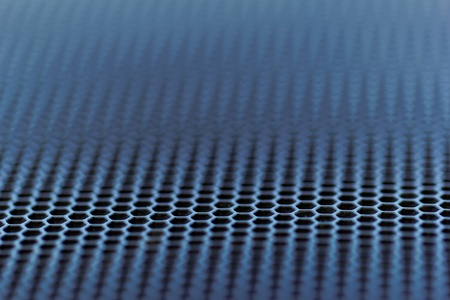 perforation texture: close up about chrome metal with holes Stock Photo
