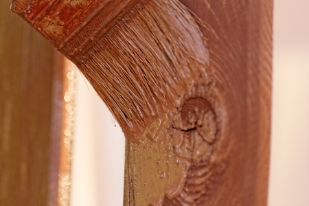 planks fence dyeing with brown paint and brush Stock Photo - 20840945