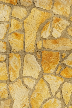 Background of a large stone wall texture (yellow) Stock Photo - 20840959