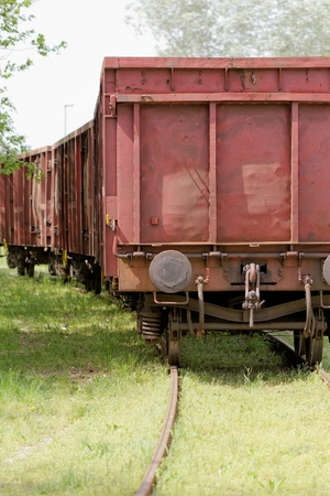 Old wagon, in an unused grassy railway track Stock Photo - 20914587