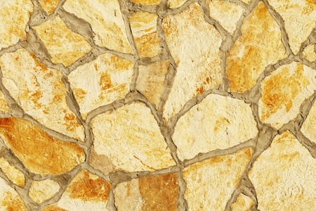 Background of a large stone wall texture (yellow) Stock Photo - 20936471