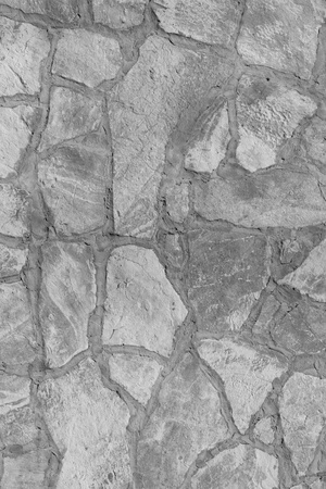 Background of a large stone wall texture (black and white) Stock Photo - 20937379