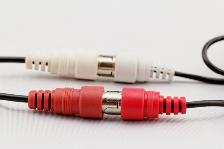 conection: correct conection between left - right audio RCA cable on a white background (red white) Stock Photo