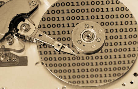 internals: Internals of a computer harddrive with binary number reflections with sepia colors (HDD, winchester)
