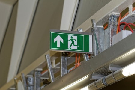 Emergency exit sign in construction site an industrial plant Stock Photo