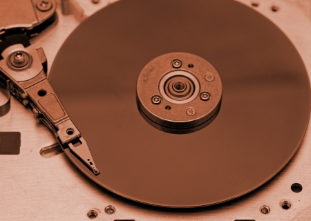 Open computer hard drive on white background with rusty color (HDD, Winchester) photo