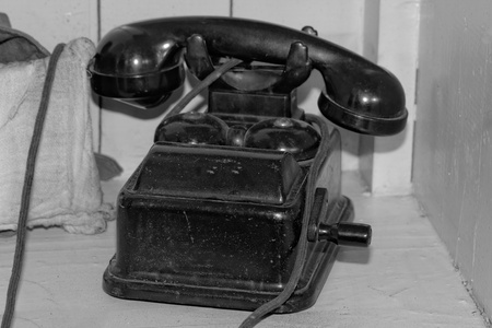 Old black phone with roll (from II world war, antique) bw Stock Photo - 21317962
