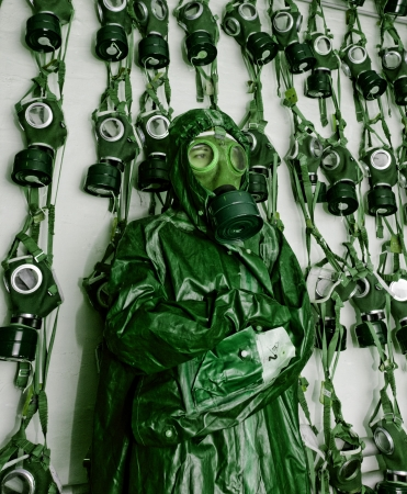 old military gas masks on a soldier woman with chemical protective suit green photo