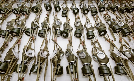 old military gas masks hanging on each other photo