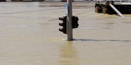 inundated: traffic light on flooding river Stock Photo