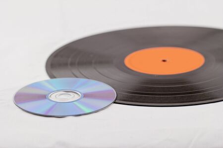 record  disk and CD (Compact disk) on white background photo