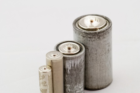 Old grey batteries on white background (aa, aaa, b, c) photo