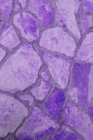 Background of a large stone wall texture (purple) Stock Photo - 21387689