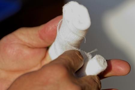 white medicine bandage on injury finger