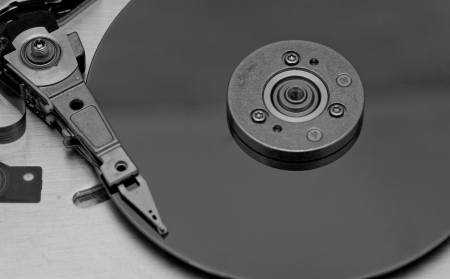databank: Open computer hard drive on white background in bw color (HDD, Winchester) Stock Photo