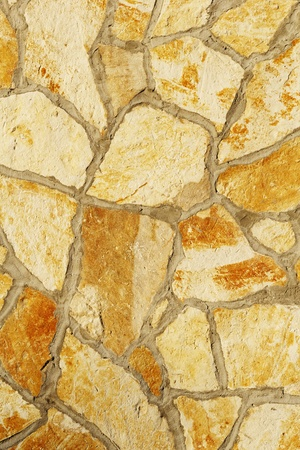 Background of a large stone wall texture (yellow) Stock Photo - 21684683
