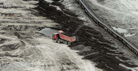 huge truck on a coal mine open pit Stock Photo - 21684698