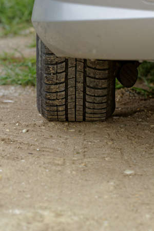 close up about car wheels on a dusty road Stock Photo - 21810570