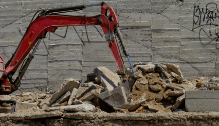 the excavator working on a construction site photo