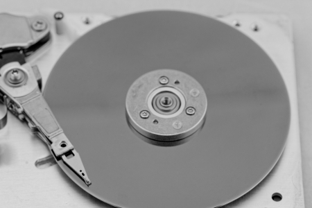 Open computer hard drive on white background in bw color (HDD, Winchester) photo