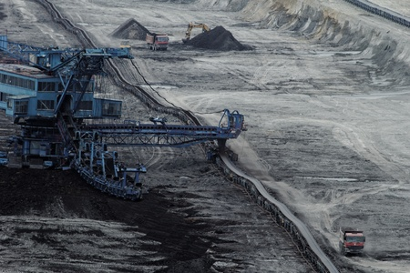 Coal mining in an open pit with huge industrial machine photo