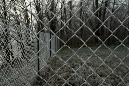 wire fence texture with hoarfrost overlay Stock Photo - 21810859