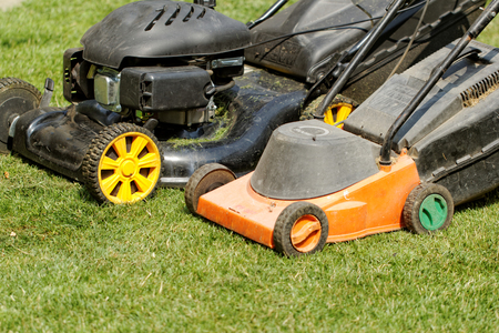 two lawnmower in the garden lawn the grass (fuel and electricity) photo