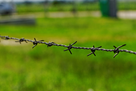 barbed wire defending the industries photo