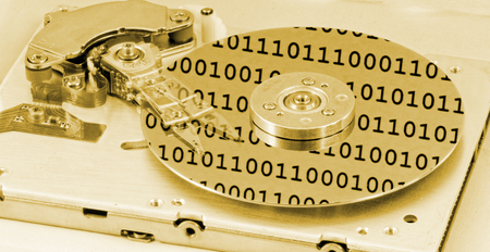 internals: Internals of a computer harddrive with binary number reflections with yellow colors (HDD, winchester) Stock Photo