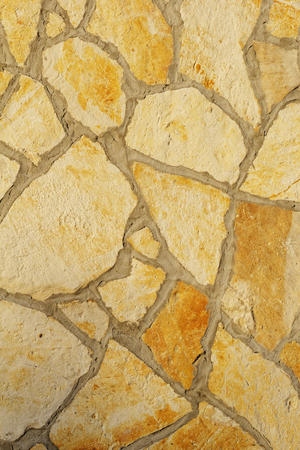 Background of a large stone wall texture (yellow) photo