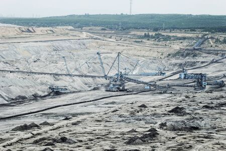 Coal mining in an open pit with huge industrial machine Stock Photo - 22487296