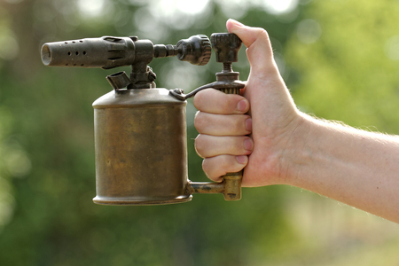 worl: close-up of a antique gasoline welder from second worl war