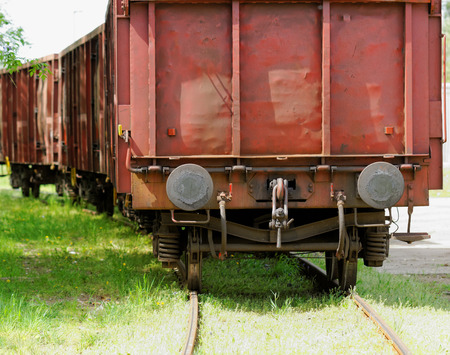 Old wagon, in an unused grassy railway track photo