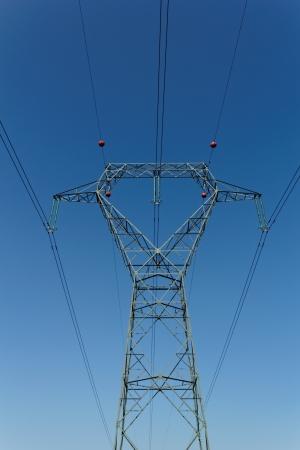 Detail of electricity pylon against blue sky  photo