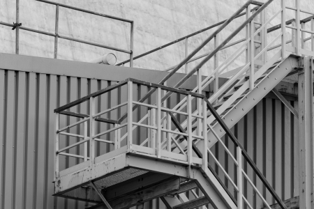 industrial stairs with stair railing wide by building photo