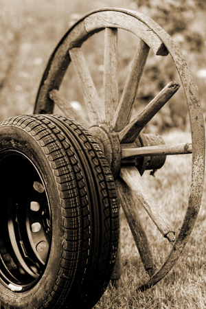 new and old broken wagon (car) wheel photo