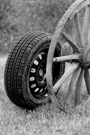 new and old broken wagon (car) wheel Stock Photo - 22608077